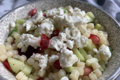 Couscous salade met granaatappel en geitenkaas
